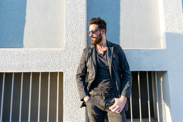 young man bearded outdoor posing