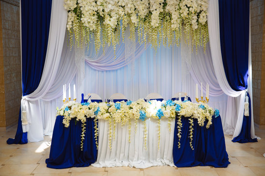Wedding accessories. The decoration of the Banquet Hall. Table newlyweds