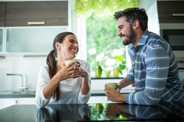 Couple interacting while having coffee