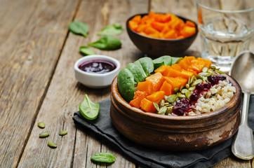rice bowl with spinach, pumpkin, pumpkin seeds and cranberry sau