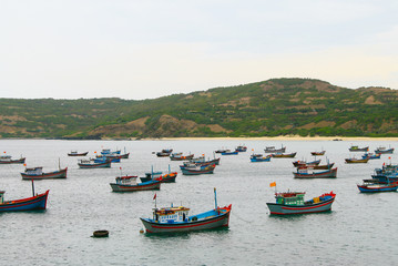 Colorful local fishing boats at a bay in Khanh Hoa province, Vietnam.