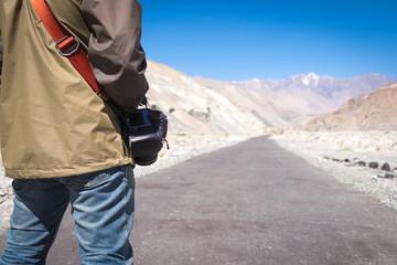 Photographer on road in desert