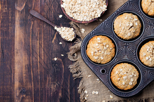 Healthy vegan oat muffins, apple and banana cakes in vintage pan. Top view. Copy space