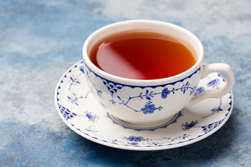 Cup of tea on a blue stone background. Copy space