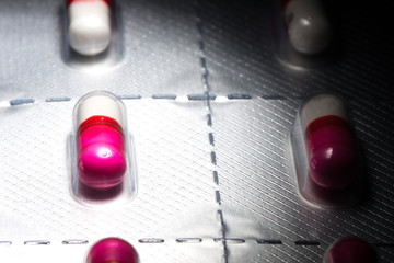 Pink antihistamine capsules in blister pack