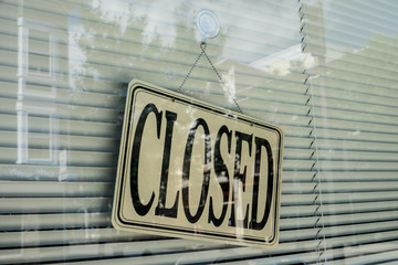 Closed sign on shop window.