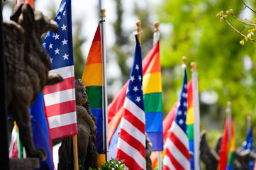 American and Rainbow flags flying together