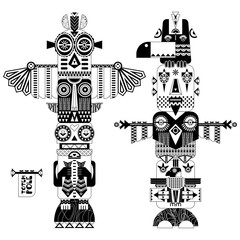 Black and white decorative totem poles.