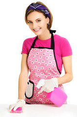 Woman cleaning kitchen counter on white