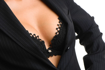 Businesswoman with suit coat open revealing cleavage bra