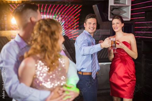 """Couple interacting with friends while dancing"" Stockfotos ..."
