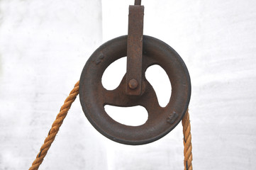 Iron pulley with jute rope.
