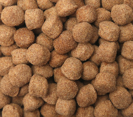 A background of brown dry dog food