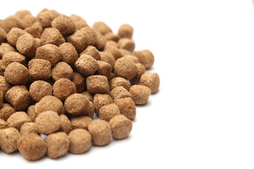 A pile of dog food isolated on a white background