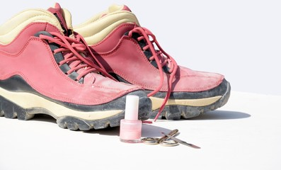 Pink working boots and manicure set, strong feminine woman concept