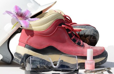 Strong woman concept. Pink working women's boots, helmet and nail varnish.