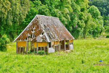 cailly, France - june 23 2016 : old barn in a meadow