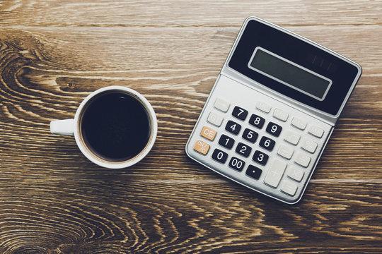 calculator and coffee