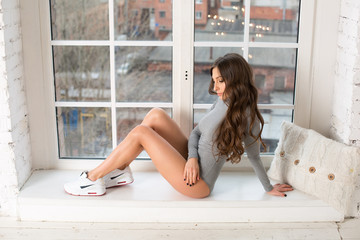 Woman on a window pill