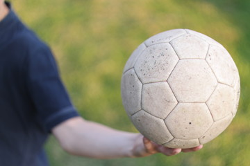 Close up of man holding soccer ball