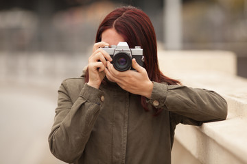 Woman Holding Camera Outdoors