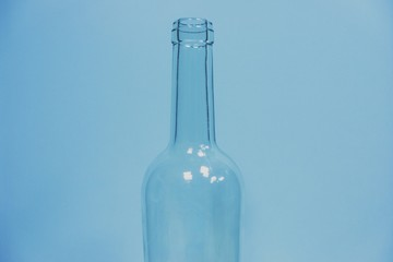 Close-Up Of Empty Bottle Against Blue Background