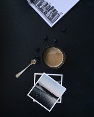 Directly Above Shot Of Coffee With Photographs On Table