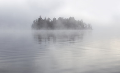 Island in the fog on Lake of Two Rivers in Algonquin Park, Canada - 122286275