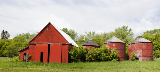 Old red barn with red silos,Manitoba canada