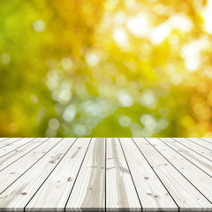 Abstract background. Wood table top on blurred sunlight