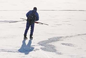 A man on skates on a frozen sea.