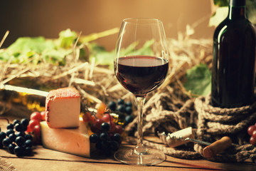 Wine bottle, glasses, grapes and cheese