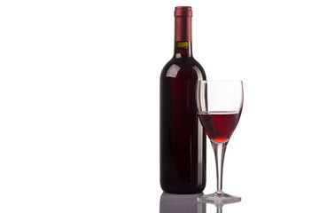 Red wine glass and bottle isolated on white background