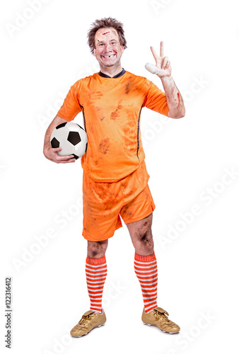 happy injured football soccer player shows a symbol of victory isolated on white background  sc 1 st  Fotolia.com & happy injured football soccer player shows a symbol of victory ...
