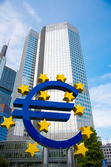 FRANKFURT - APRIL 30: The Famous Big Euro Sign at the European Central Bank. The bank was established by the Treaty of Amsterdam in 1998; April 30, 2016 in Frankfurt, Germany.