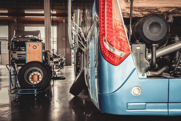 bus and truck waiting for service in the garage, vintage photo a