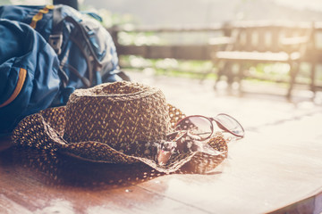 Travel backpack with hat and sunglasses