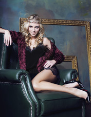 young blond woman wearing crown in fairy luxury interior with empty antique frames total wealth long legs