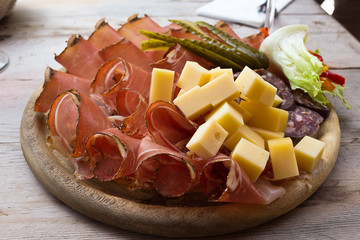 Speck and cheese cold cuts platter - South Tyrol. The plate after alpine trekking: typical food - Puster Valley