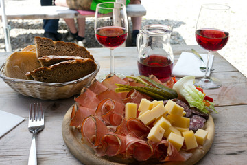 Speck, cheese and bread typical delights served at the alpine huts - - South Tyrol
