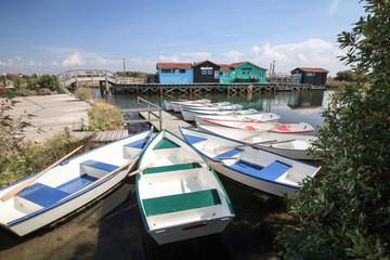 petites barques colorés au port des salines sur l'ile d'oléron avec ses cabanes en bois Wall mural