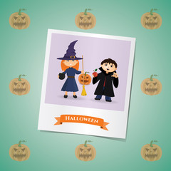 Photo of girl and boy in costumes of witches and Dracula's on the Halloween
