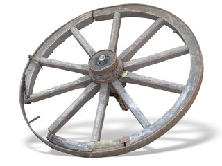 Antique Cart Wheel made of wood and iron-lined isolated over whi