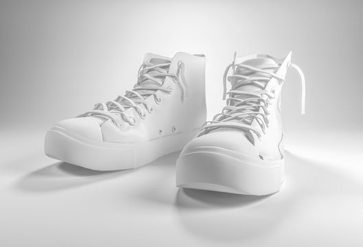 Pair of generic white lace up sneakers