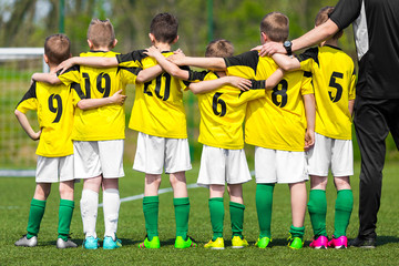 Youth sports team. Young players standing together with coach manager. Youth and sports; team spirit