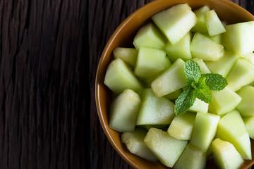 Fresh melon sliced on wooden table. Melon sliced.