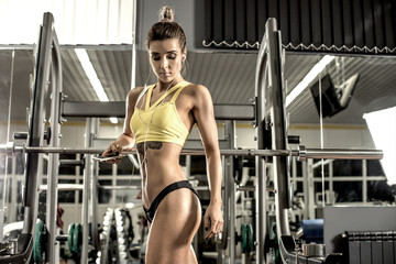 young fitness woman tired in gym and listen music with headset