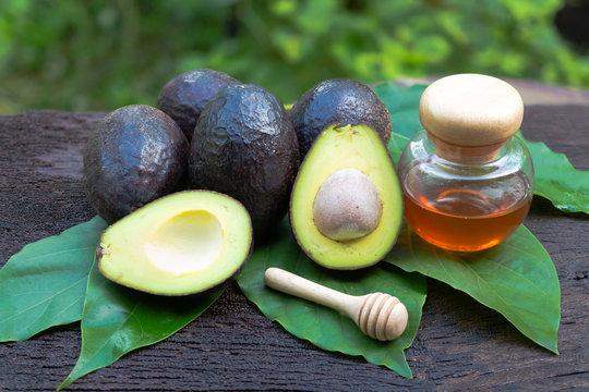 Fresh avocado with  honey on wooden background