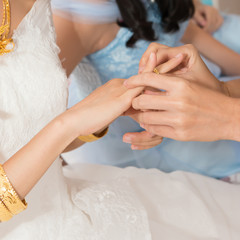 friends helping the bride wearing a gold wedding ring