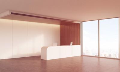 Side view of reception desk in sunlit corridor